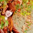 Redhead girl in fall time — Stock Photo