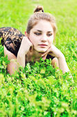Teen girl in grass — Stock Photo