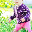 Baby in spring time — Stock Photo
