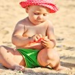 Baby playing on the beach — Stock Photo #27792259