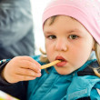 Girl eating french fries — Stock Photo #27827095