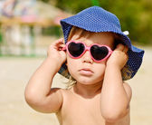 Fashion toddler on the beach — Stock Photo