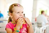 Girl with hamburger — Stock Photo