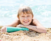 Happy boy on sea shore — Stock Photo
