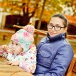 Mother with baby daughter in autumn park — Foto Stock