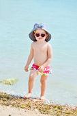 Toddler girl on beach — Stock Photo