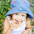 Toddler girl eating cracknel — Stock Photo #29060115