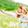Fun in daisy field — Stock Photo