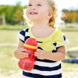 Toddler girl with bottle of water — Stock Photo