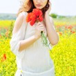 Beautiful girl in rapeseed field — Stock Photo