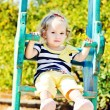 Stock Photo: Swinging toddler