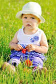 Baby on lawn — Stock Photo