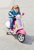 Girl on motorcycle — Stock Photo