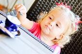 Toddler girl in cafe — Stock Photo