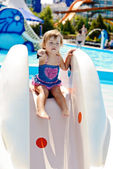Cute toddler in aqua park — Stock Photo