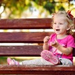 Toddler girl on the bench — Stock Photo