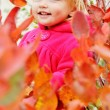 Toddler girl standing in bushes — Stock Photo