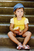 Cute toddler eating outdoors — Stock Photo