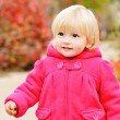 Baby girl walking in fall park — Stock Photo #30462701