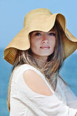 Woman in straw hat — Stock Photo