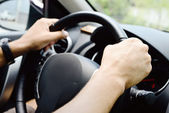 Hands on wheel — Stock Photo
