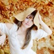 Beautiful woman wearing straw hat — Stock Photo