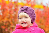 Baby girl in fall — Stock Photo