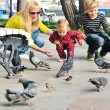 Family feeding doves — Photo