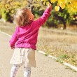 Baby girl with autumn leaves  — Stockfoto