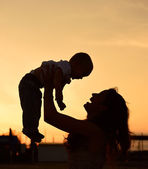Mother and baby son silhouettes — Stock Photo