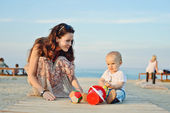 Mother and baby son playing toys — Stock Photo