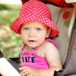 Funny baby in stroller — Stock Photo #31890777