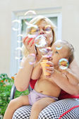 Fun of mother and baby — Stock Photo