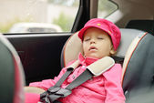 Girl sleeping in car seat — Stock Photo