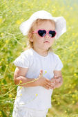 Toddler in the yellow rape field — Stock Photo
