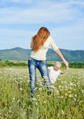 Mother and son playing in field — Stock Photo