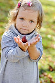 Cutie with chestnut — Stock Photo