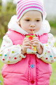 Toddler with juice — Stock Photo