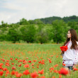 Ukrainian girl in poppy field — Stock Photo