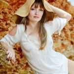 Beautiful woman wearing straw hat — Stock Photo #35063543