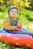 Baby boy in fall — Stock Photo