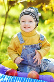 Happy baby boy in fall time — Stock Photo
