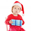 Santa helper with gift — Stock Photo