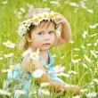 Girl on the daisy meadow — Stock Photo