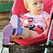 Baby  in red stroller — Stock Photo