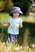 Girl walking in grass — ストック写真