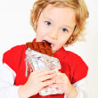 Stock Photo: Girl eating chocolate