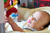 Baby in bouncer chair — Stock Photo