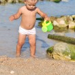 Baby playing on the beach — Stock Photo #37566463