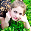 Teen girl relaxing in the grass — Stock Photo #3817976
